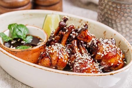 chicken wings in sauce teriyaki grilled on plate