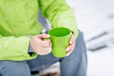 woman take break from hiking and drinking tea. Bushcraft concept