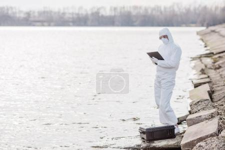 Scientist or biologist wearing protective uniforms examining the