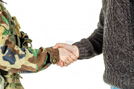Soldier shaking hands with civil man