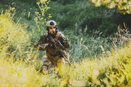 soldier of special forces in action pointing target and giving a