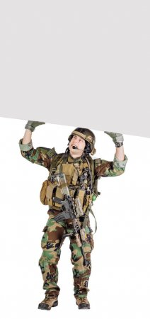 soldier with rifle  holding white panel with space for text on white background.