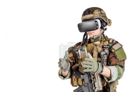 soldier wearing virtual reality glasses. Military and technology concept.