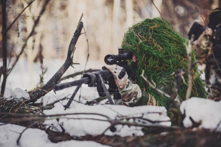 Army sniper during the military operation in the mountain. war,