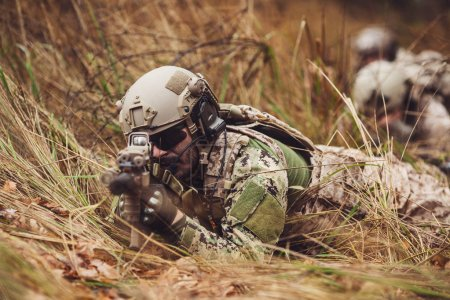 soldiers or private military contractors aiming with rifle. war,