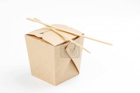 WOK paper box  with food and chopsticks isolated on white backgr