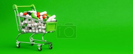 Small shopping cart full of pills. Medicine and pharmacy concept