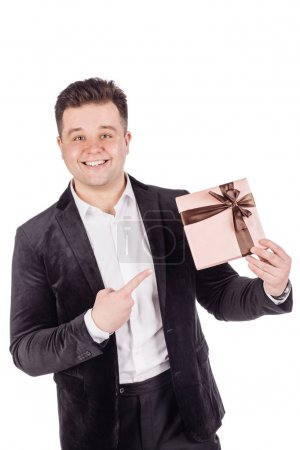 man opening a surprise gift box with a bow with a look of joyful