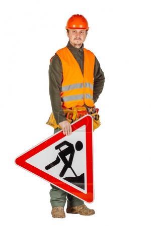 male builder or manual worker in helmet holding a roadworks  sig