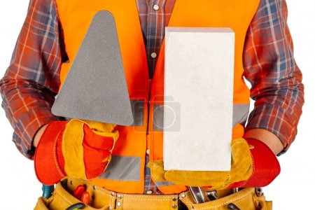 Builder worker with a brick and trowel in hands isolated on whit