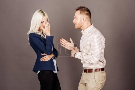 boss yelling at woman after for disagreement, misunderstanding o