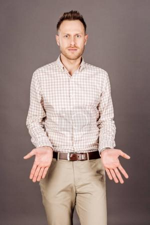 Photo for Man with arms wide open. emotions, facial expressions, feelings, body language, signs. image on a dark studio background. - Royalty Free Image