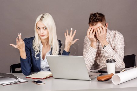 Female boss yelling at man after for disagreement, misunderstanding or unfair treatment in workspace. business conflict concept.