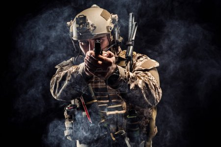 soldier or private military contractor holding rifle. Image on a