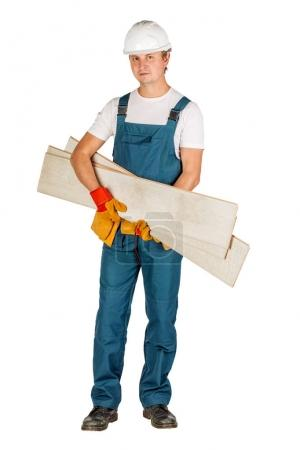 Full length portrait of a male builder in a helmet  over white wall background. repair, construction, building, people and maintenance concept.