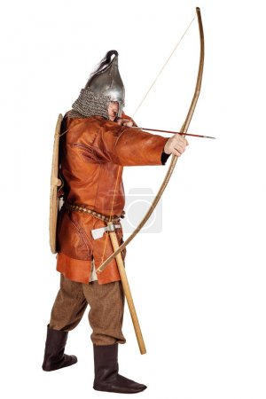 portrait medieval slavic soldier holding a bow and arrow. image on white studio background. historical concept.