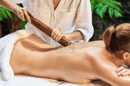 Asian back massage therapy spa hot stone relaxing
