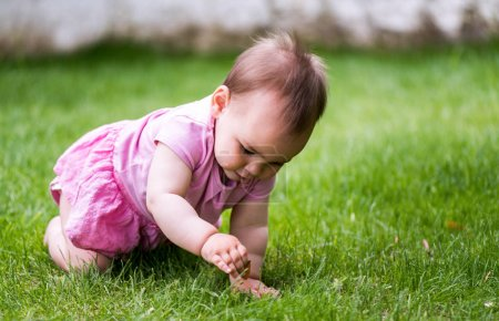Sweet Baby Girl Playing On Grass In Nature