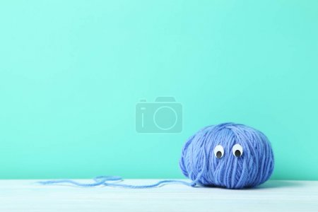 Ball of yarn with googly eyes