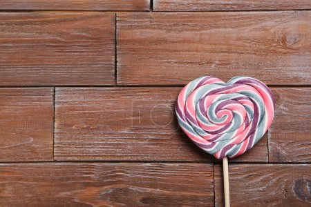 Photo for Sweet lollipop on a brown wooden table - Royalty Free Image