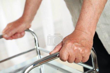 hands holding on a walker