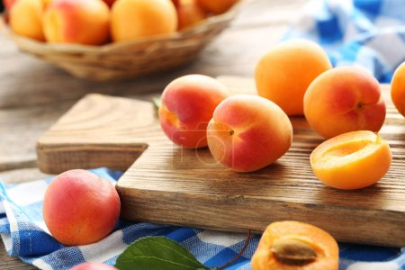 Ripe apricots on table
