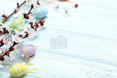 Tree branches with flowers and easter eggs