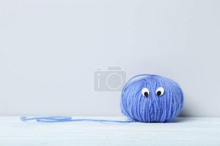 Ball of yarn with eyes