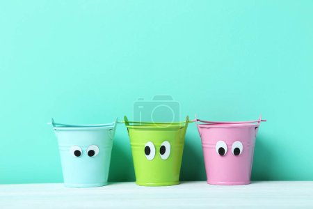 Colorful buckets with googly eyes