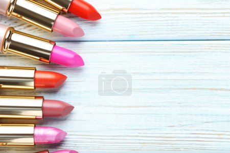 Colorful lipsticks on table