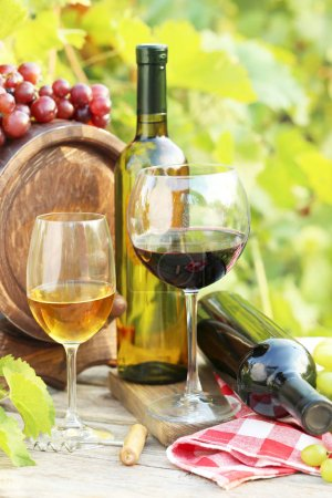 Wine in glasses with bunch