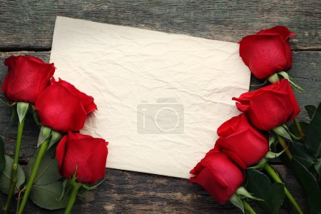 Red roses with blank sheet