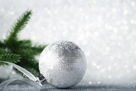 Silver christmas bauble with ribbon