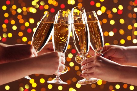Hands holding champagne glasses