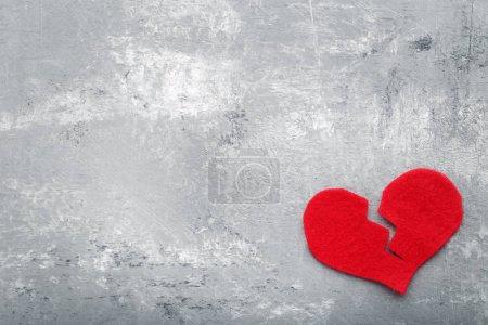 Broken red heart on  table