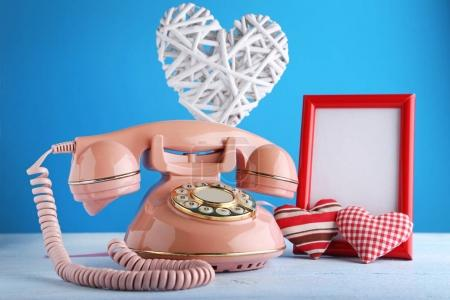 Pink retro telephone with photo frame
