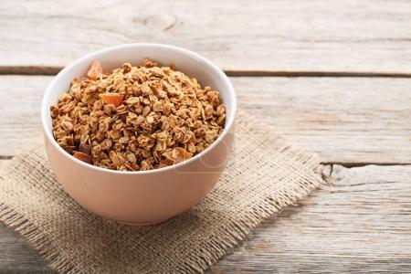 Tasty granola in bowl