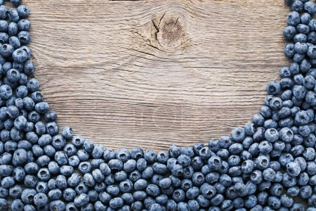 Ripe blueberries on grey