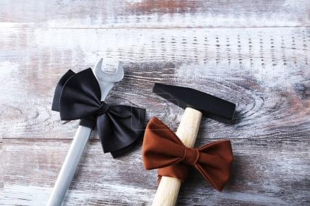 Wrench and hammer with bow tie