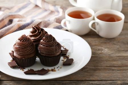 Tasty cupcakes with pieces of chocolate