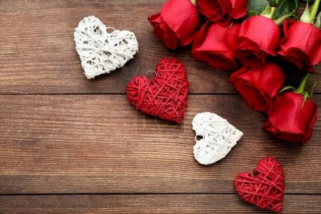 Bouquet of roses with red and white hearts