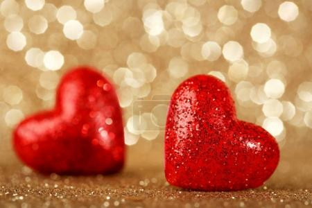 Red hearts on bright lights background