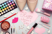 Inscription Happy women's Day with high-heeled shoes and makeup cosmetics
