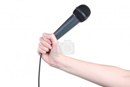 Female hand holding microphone on white background