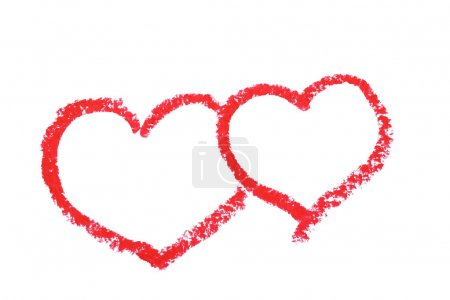 Red hearts drawn by lipstick on white background