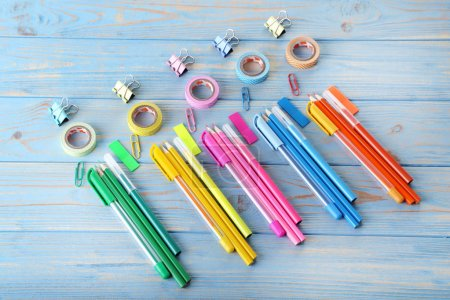 Colorful supplies on blue wooden table