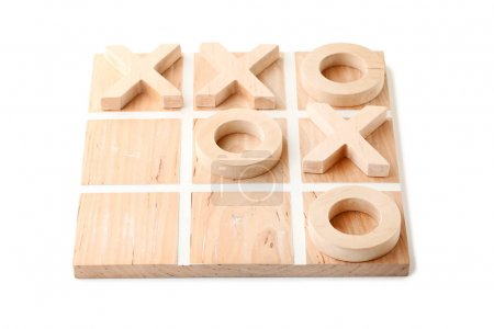 Wooden tic tac toe game isolated on white