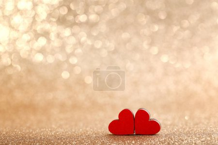 Red wooden hearts on lights background