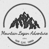 Logan in Saint Elias Canada outdoor adventure logo Round hiking vector insignia Climbing trekking hiking mountaineering and other extreme activities logo template