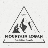 Logan in Saint Elias Canada outdoor adventure logo Triangular mountain vector insignia Climbing trekking hiking mountaineering and other extreme activities logo template